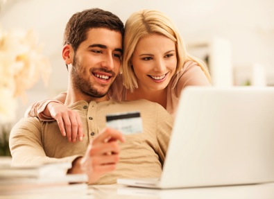 Young couple using e-commerce website to buy online