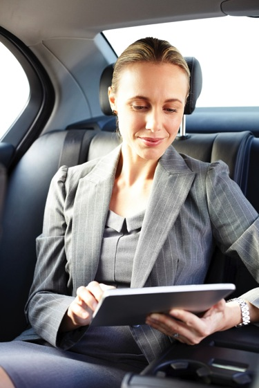 Executive woman tablet car