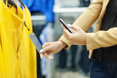 Young woman shopping on phone: can't miss mobile commerce