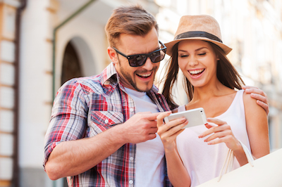 Couple enjoying 10 damn-good digital marketing posts on their mobile phone