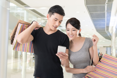 Massive mobile disruption: Couple shopping with mobile web