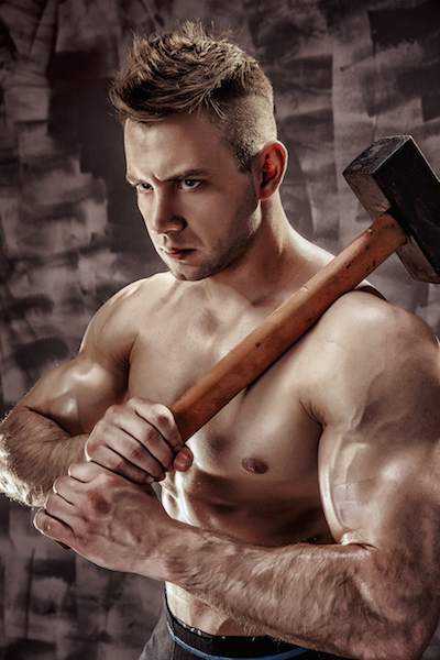 Content Marketing is a Powerful Hammer But Not Everything is a Nail: Man holding a large hammer