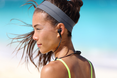 The Future of Digital Arrived Last Week (Thinks Out Loud Episode 177): Woman wearing wireless headphones