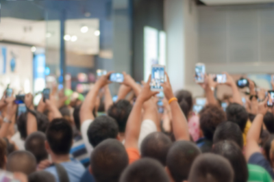 Why Digital Transformation Matters: Crowd of people all using mobile phones