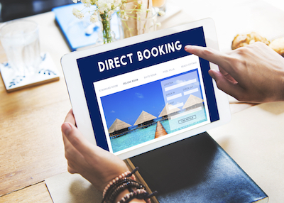 Trends Driving Hotel Digital Marketing: Guest shopping on tablet for hotel direct booking