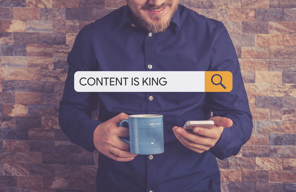 Man Searching For Content On Phone (Is Content Is King Dead?)