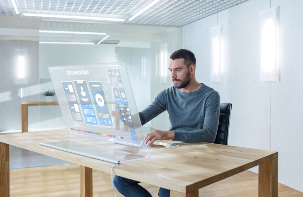 Is AI Still A Big Business Trend? Man Using AI Powered Touch Interface